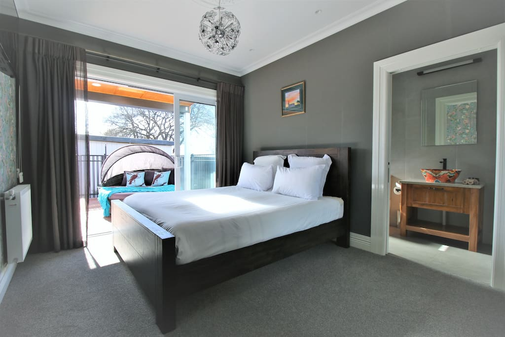 Wake up in your Memory Foam bed, if you can! Our floor to ceiling block out curtains make it difficult to get up!