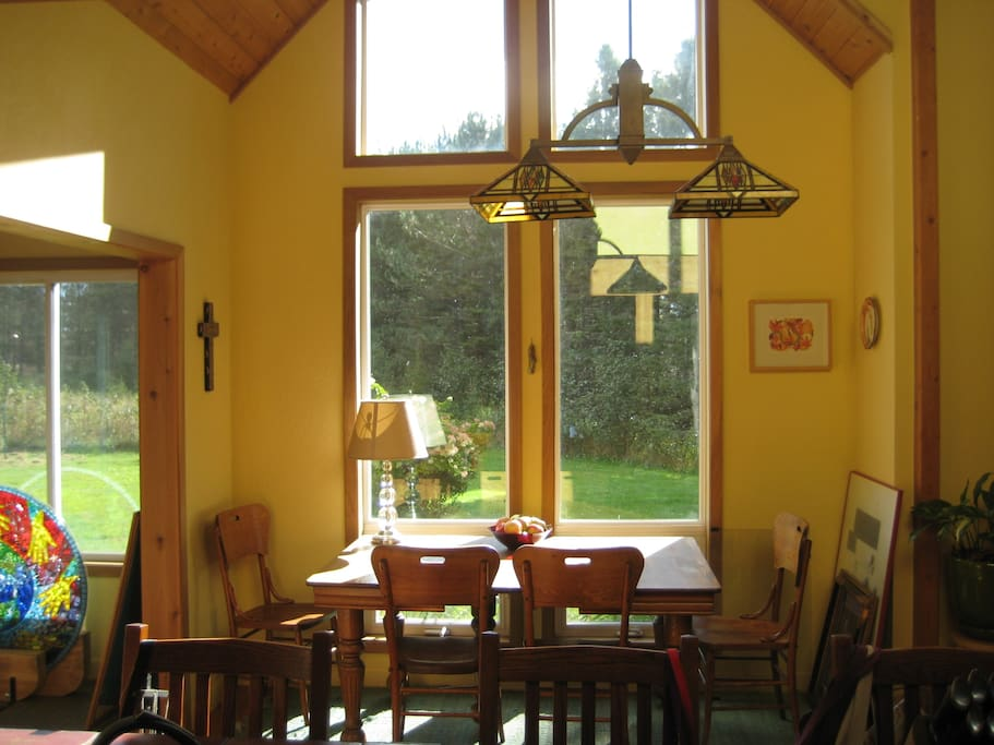 The morning light through the dining room windows. A great place to sit, have a meal or coffee.