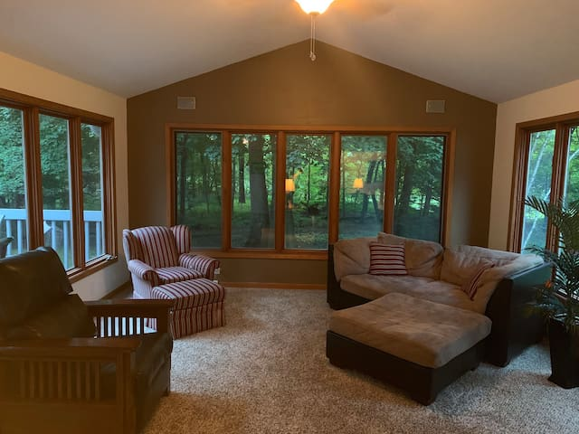 Attached to living room is viewing room and access to the deck