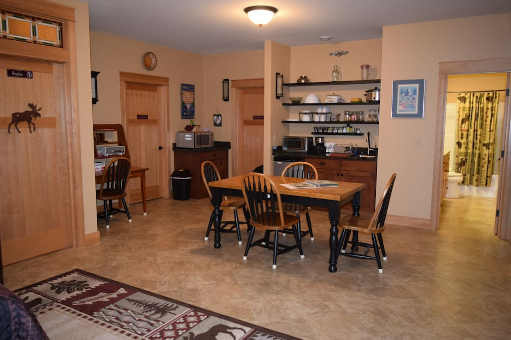 Furnished kitchenette, dining area, desk area and bathroom layout.