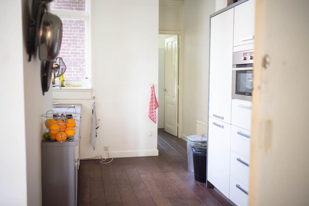 Kitchen and hallway to bedroom