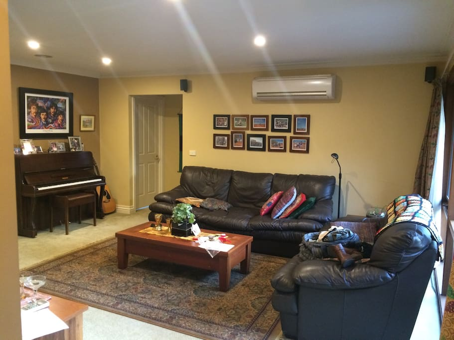 Large communal lounge area with piano!