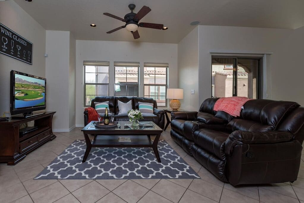 Living room with comfortable furnishings and flat screen TV