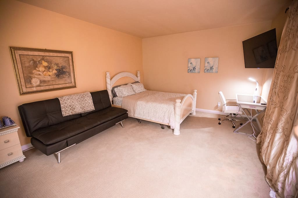 Queen bed and frame, premium leatherette futon that converts into a full-size bed, and