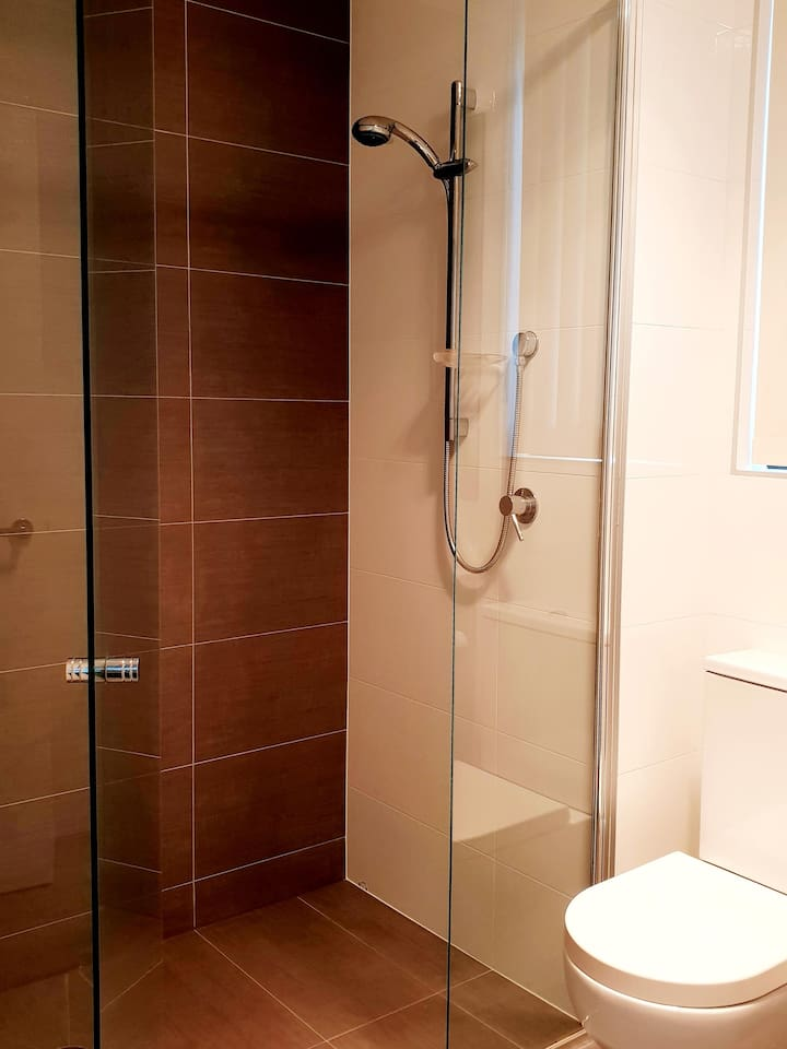 Luxurious bathroom with walk in shower and free amenities