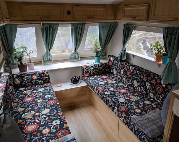 Hikers caravan on WHW with loch/mountain views