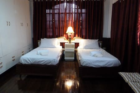 Two Cozy Beds in Our Ali'i Room - Legazpi City - Casa