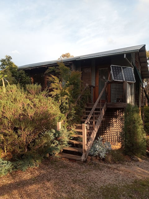 plugged-in consumers need not apply to this off-grid ,in the trees, wood heated, guest house with no hot shower.