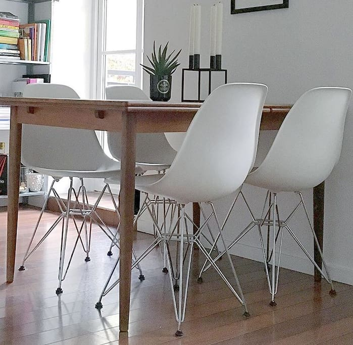 Dining table with designer chairs