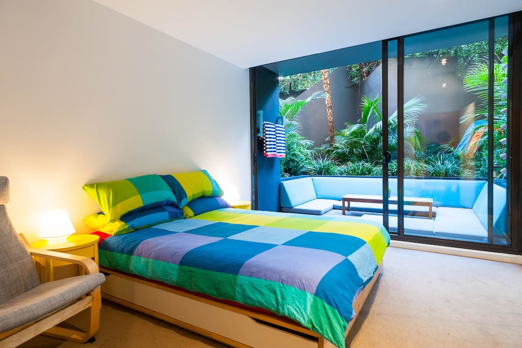 The room features a new deluxe latex bed with fresh cushions and view to   private rainforest patio.