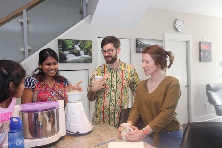 Guests enjoying milk tea and observing