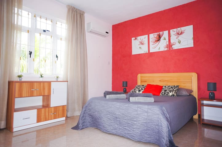 Master bedroom with personal balcony , air con and wardrobe