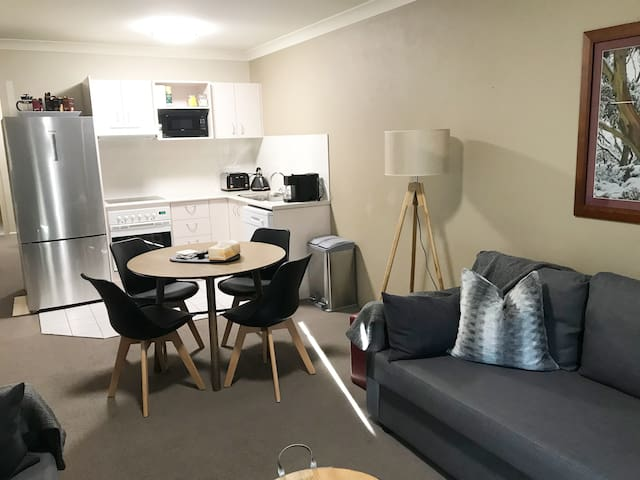 Lounge room/Kitchen/dining with brand new furniture, lots of cooking pots, fry pans, plates, cutlery, wine & champagne glasses, capsule coffee machine (Aldi capsules)