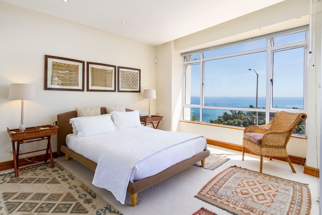 Spacious bedroom with ocean views and direct access to the balcony.