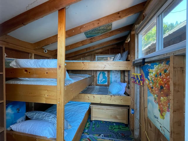 Separate bunk room off of deck with 4 twins available for extra nightly fee.