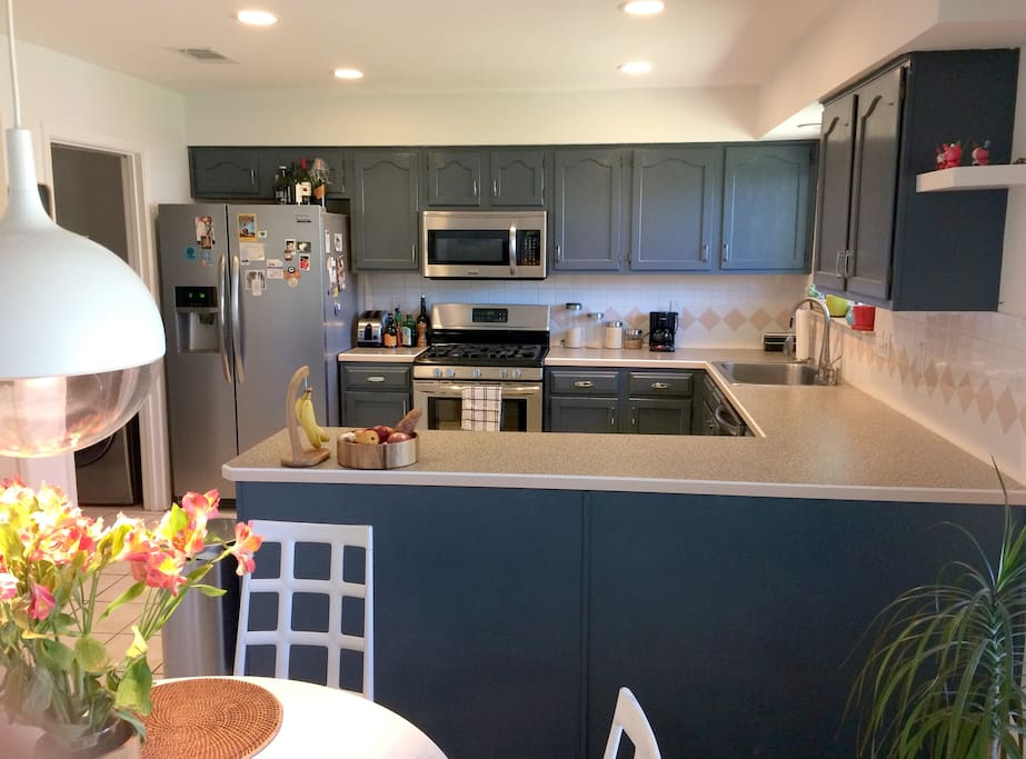 Enjoy an open kitchen and dining space with full access to the stove, refrigerator, plates, glasses, and silverware. Coffee is available every morning upon request