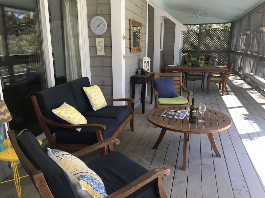 Back deck perfect for entertaining, with a seating area and dining table.