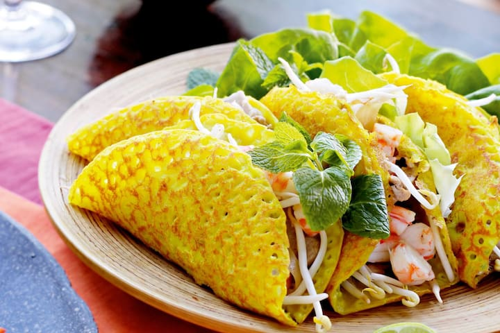 Locals know Ba Duong as one of the best places for banh xeo, a crackling fried rice flour crepe filled with bean sprouts, shrimp, spring onions, and mung beans.