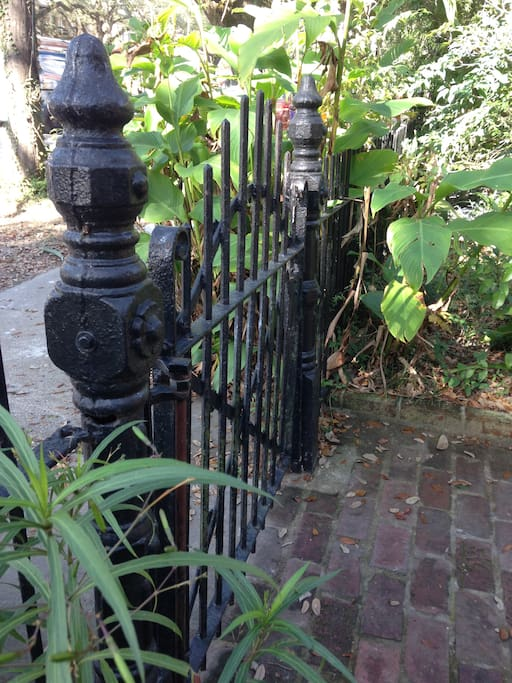 Ornate, historical gate and fence that outlines the front of the house & gardens.   Authentic wrought iron fencing that is original to the home; made in late 1880's.