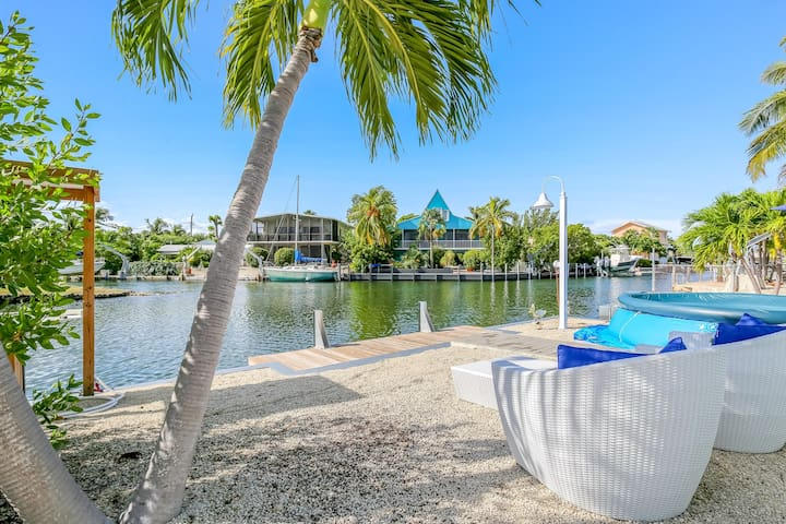 NEW LISTING! Canal front home with private boat ramp, pool, and kayak!