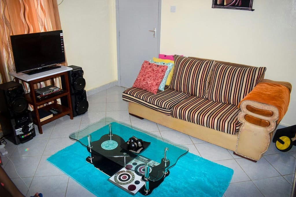 neat spacious living room area. tv cable, music system and wifi available