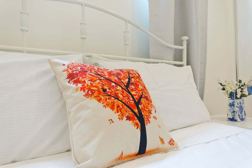 Enjoy the touch of trend with this artsy pillow.