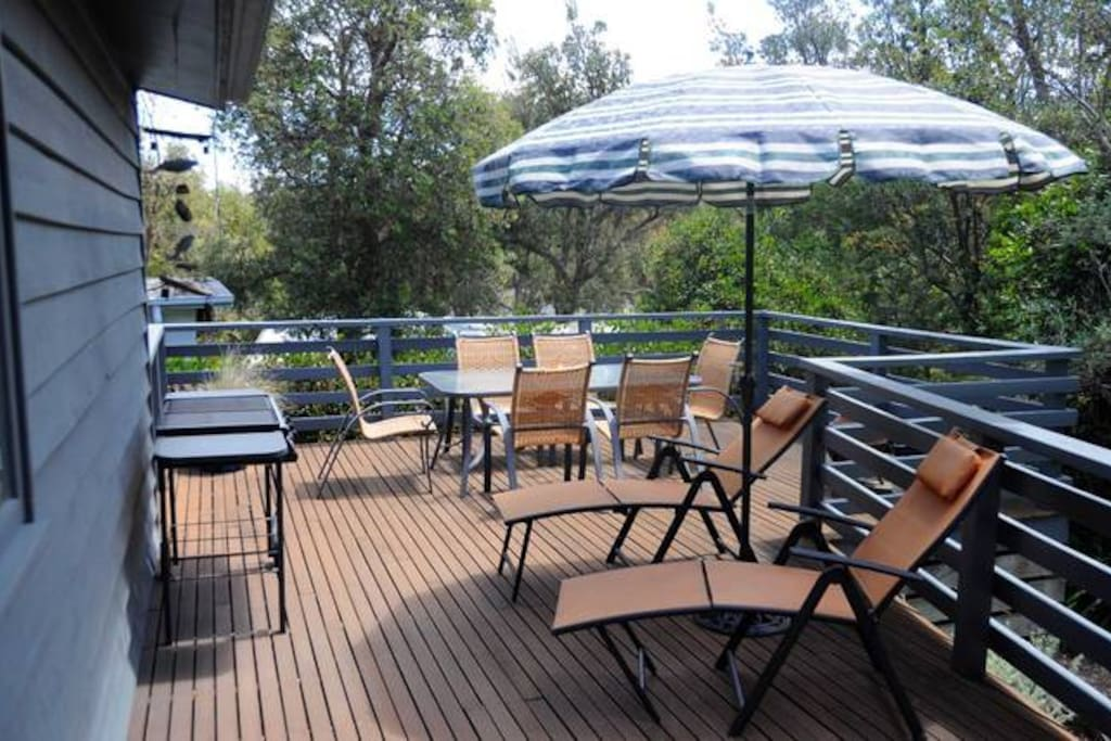 The back decking serves every purpose for a beach house: entertaining, relaxing under the sun, or enjoying some quiet time.