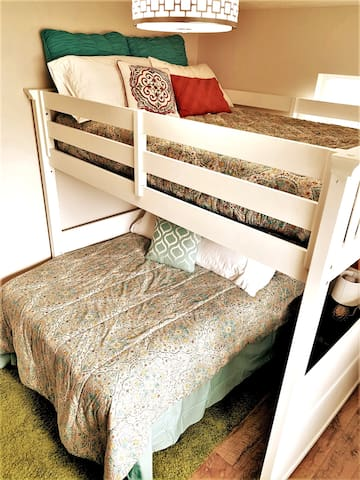 Bedroom three has bunk bed with two double beds.  This room also has a small desk.