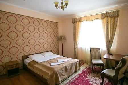 """Уютный номер в отеле """"Белые ночи"""" - Dombay"""