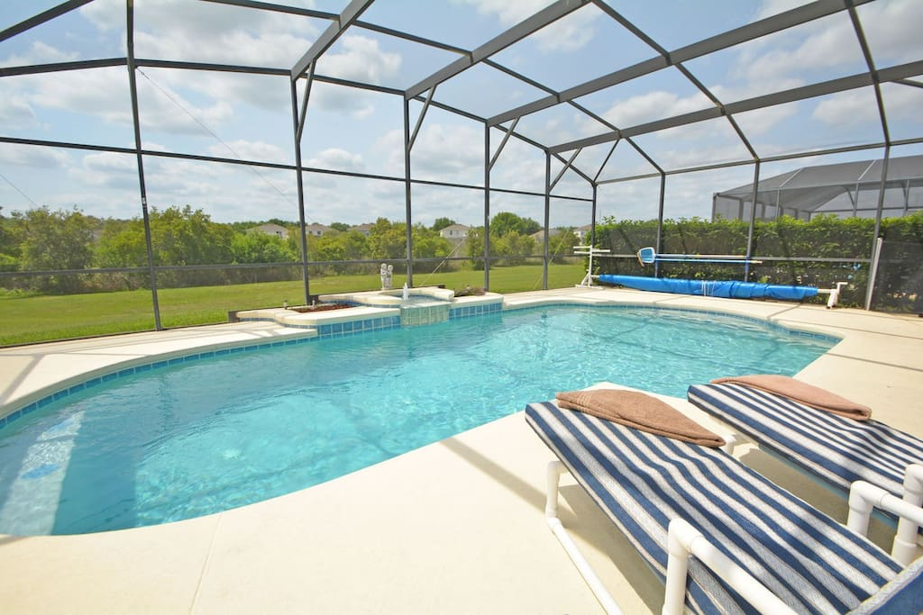 Pool with view of trees/grassy area