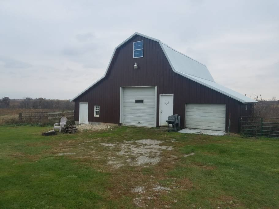 Front view of barn. Fire ring with wood provided.