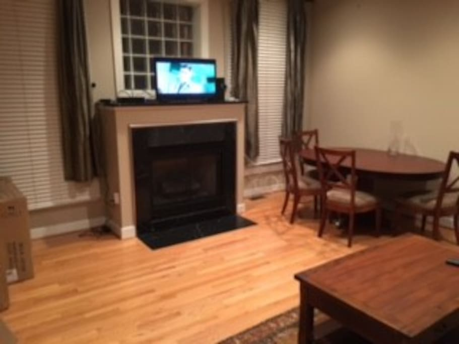 A gas fireplace adds to the apartment's ambiance.
