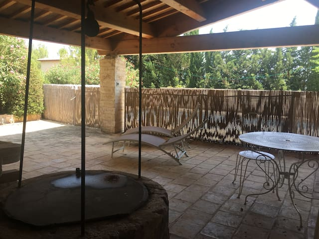 The covered terrace (auvent) is a much appreciated haven during hot hours and for eating al fresco. It also features an old well (safely sealed).