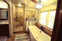 Shower with five shower-heads and body sprayers.