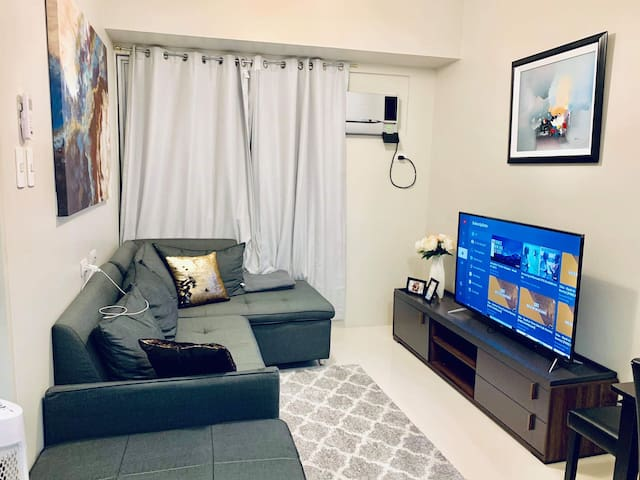 Modern 1BR corner unit w/ Netflix in Mandaluyong
