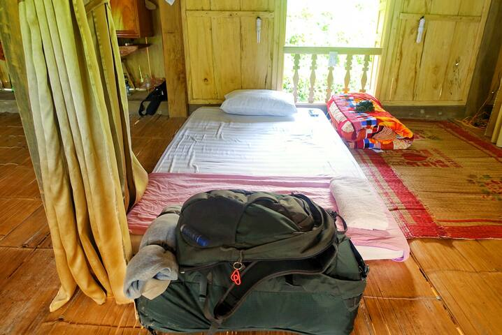A typical floor bed arrangement. There are power outlets, personal lights, and and privacy curtains for each bed.