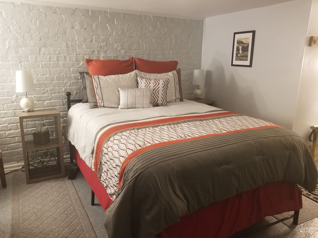 Our luxurious queen bed with USB charging nightstands!