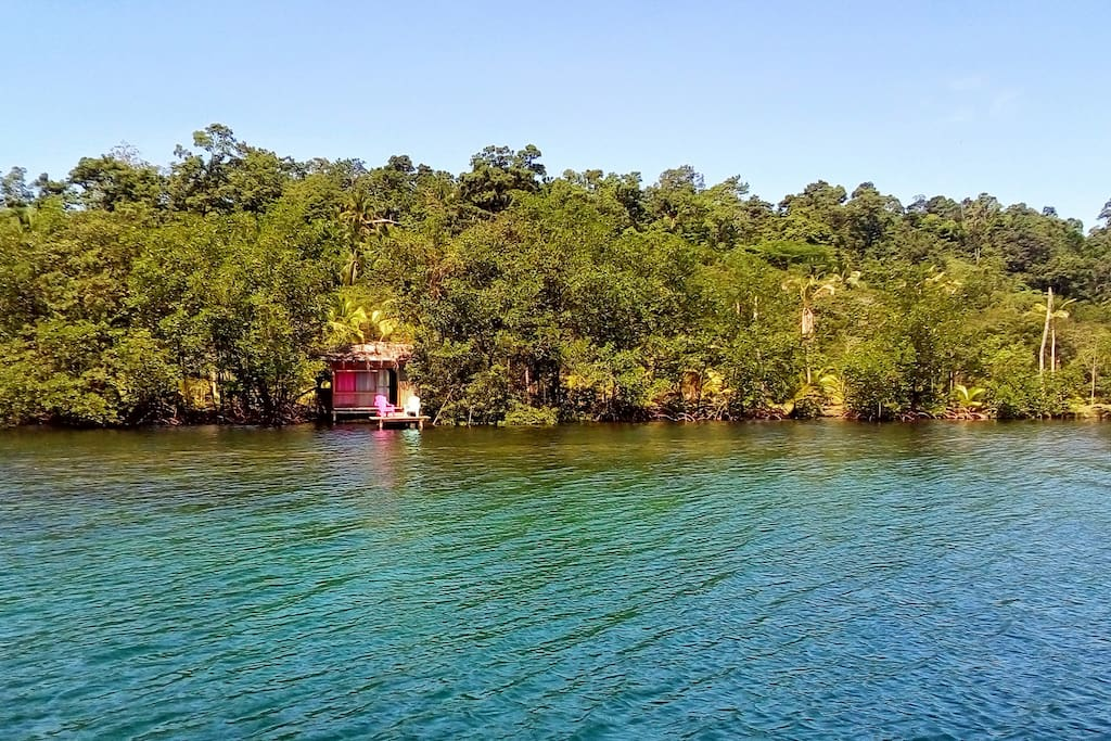 The Hidden Treasure Cabin sits on stilts over a turquoise lagoon, a beautiful reef at your doorstep.