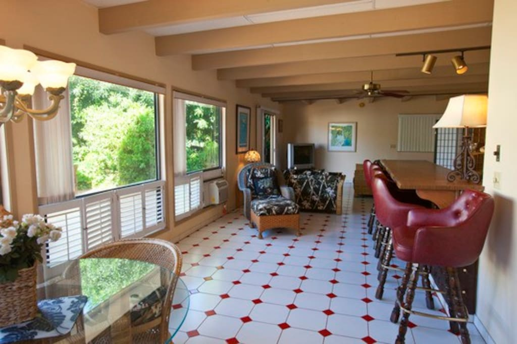 The poolside studio has a very open and airy feel looking out to the pool and jacuzzi