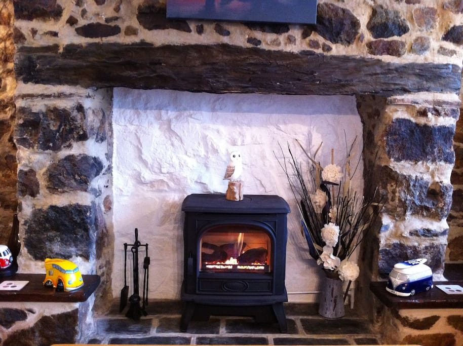 Gas log effect stove in lounge inglenook