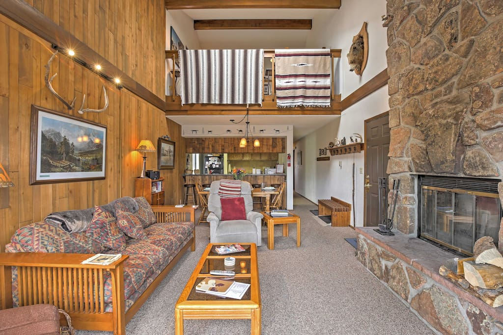 High vaulted ceilings welcome you into this two-story, lofted unit.