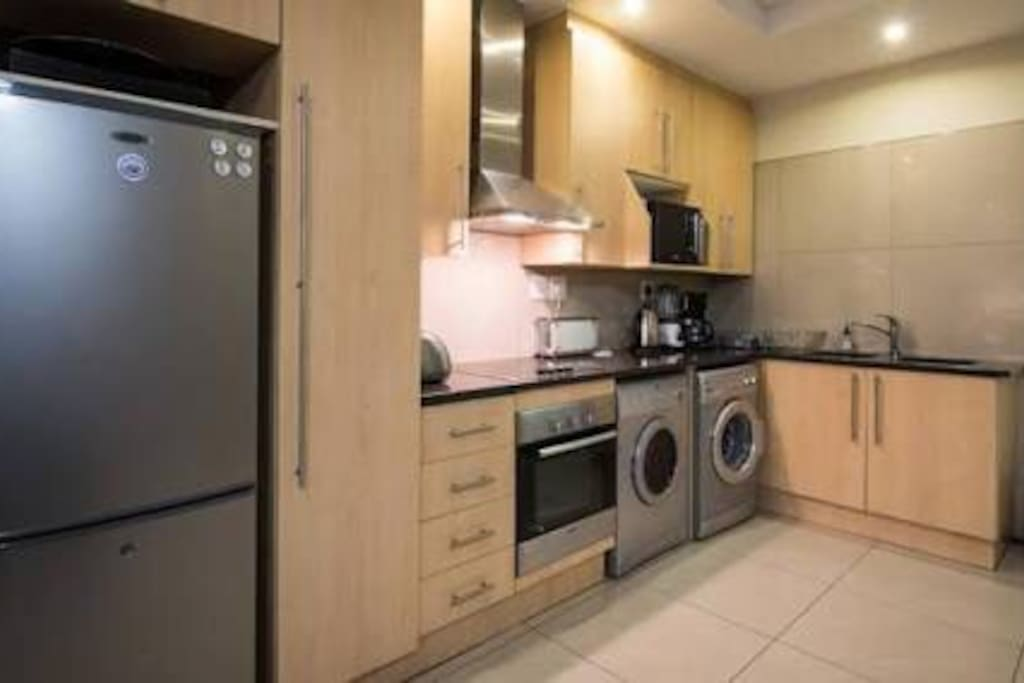 Kitchen: equipped with fridge & freezer, oven, stove top and hub. Dryer and washer,double wash up basin, and lots of counter space, cupboards and appliances : kettle, toaster etc