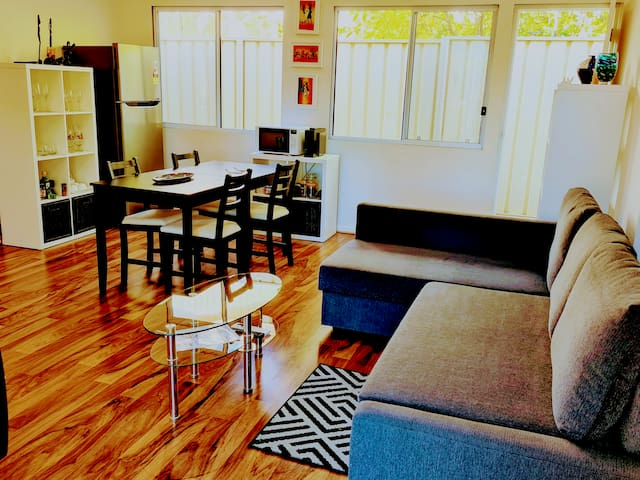 Entrance to guest apartment with skylights. Livingroom, has sleeper couch that converts to double bed.Kitchenette has 2 plate ceramic cooker, fridge/freezer, microwave, coffee machine, table& 4 chairs, reverse cycle AC. Separate bedroom with ensuite.