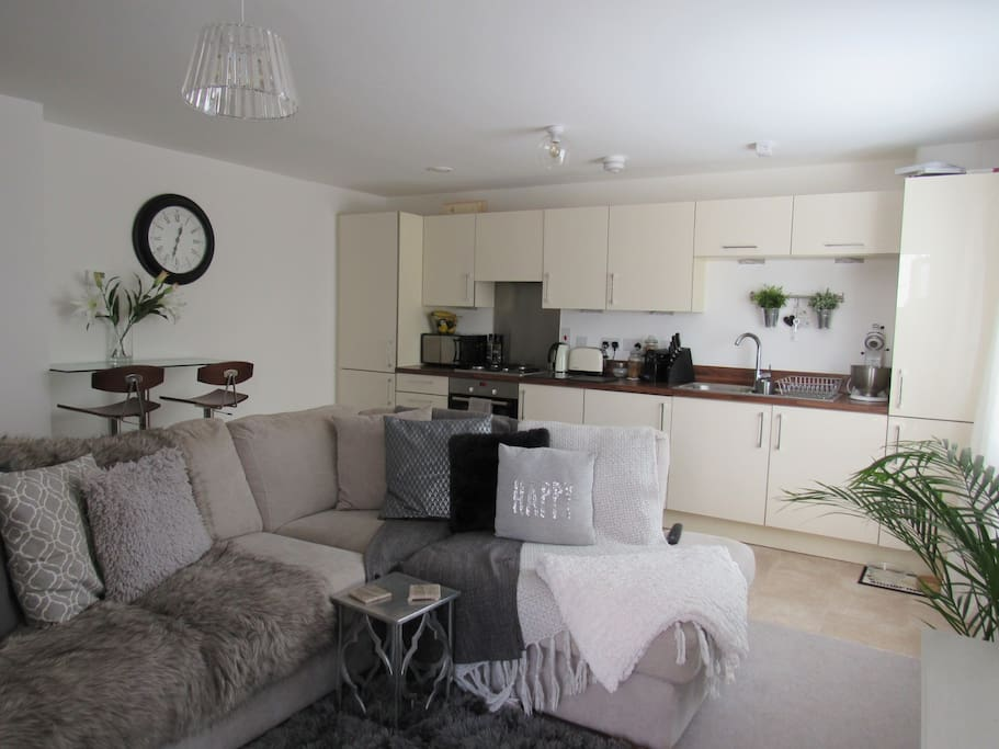 Connecting kitchen and sitting room, large sofa could easily sit 5 people!