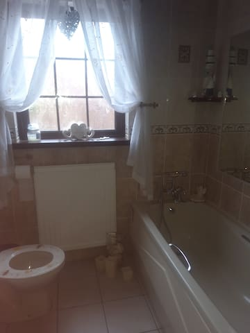 Shared bathroom and shower on ground floor.
