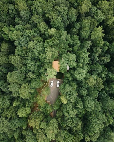 Drone view of treehouse secluded in the woods!