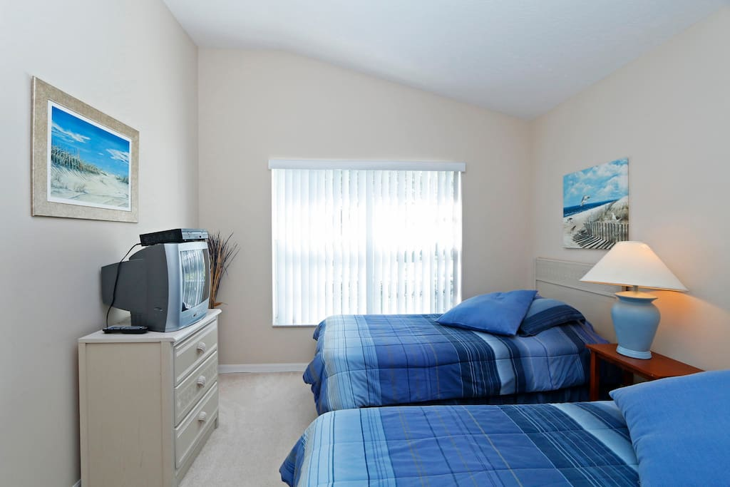 Twin bedroom with t.v.