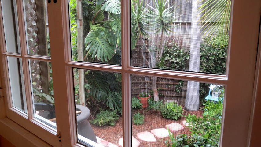 The wide wooden windows open on to your private garden patio in two directions, letting in not only lots of light but also cool ocean breezes.