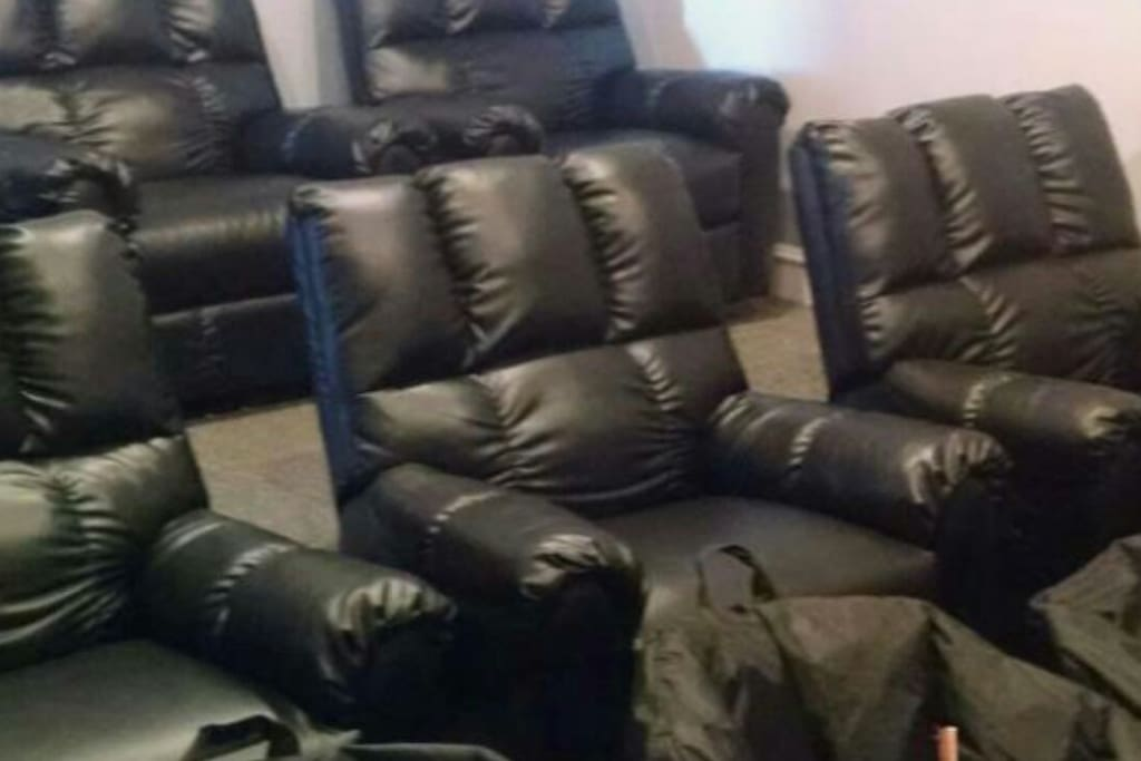 Massage recliner seats in the theater room