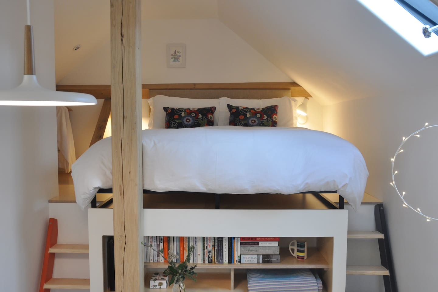 The king sized bed on mezzanine platform with ladder access
